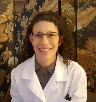 Dr. Rhonda Hogan DACM, Acupuncturist in a lab coat